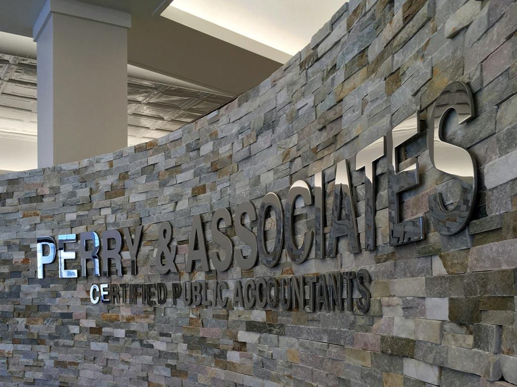 Perry & Associates indoor metal sign