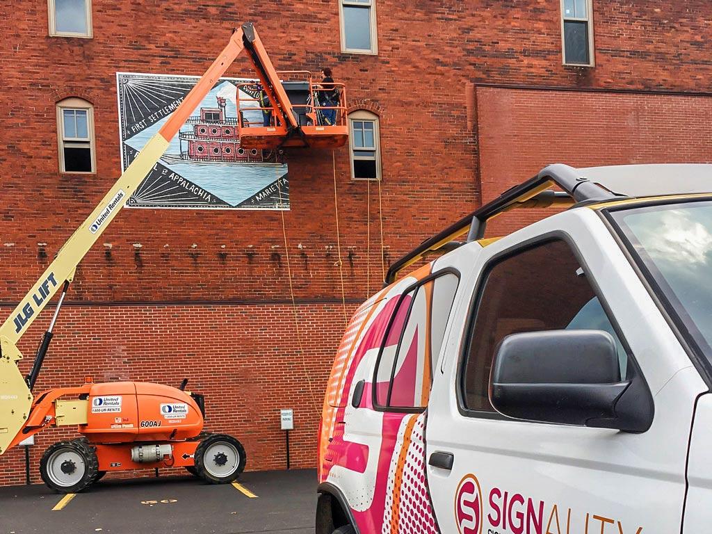 Sternwheel Sign Brick Wrap installation